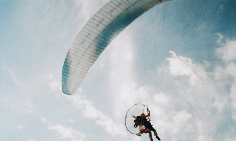 Soar the skies while paragliding